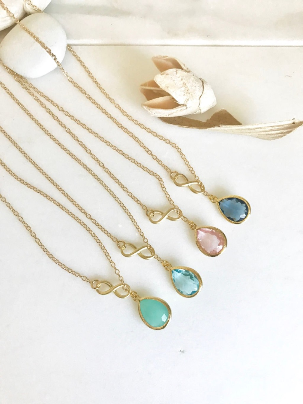 The teardrop pictured measure about 11mm x 17mm. Necklaces are made 17