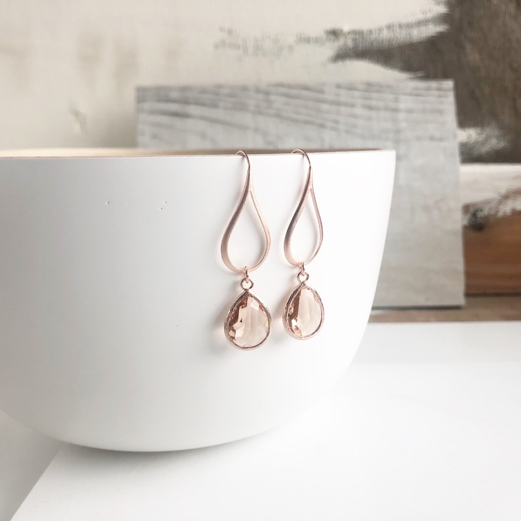 The stones are glass set in rose gold plated brass and measure about 16mm long. The earrings are about 1.75 from the top of the earwire