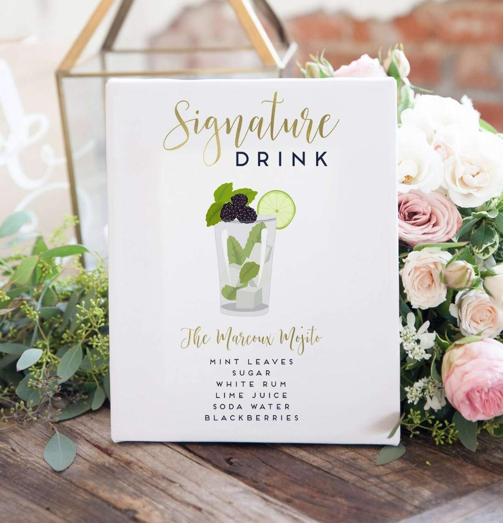 This super cute Signature Cocktail Sign with Drink Illustration is the perfect sign to sit on your wedding day bar to let your guests