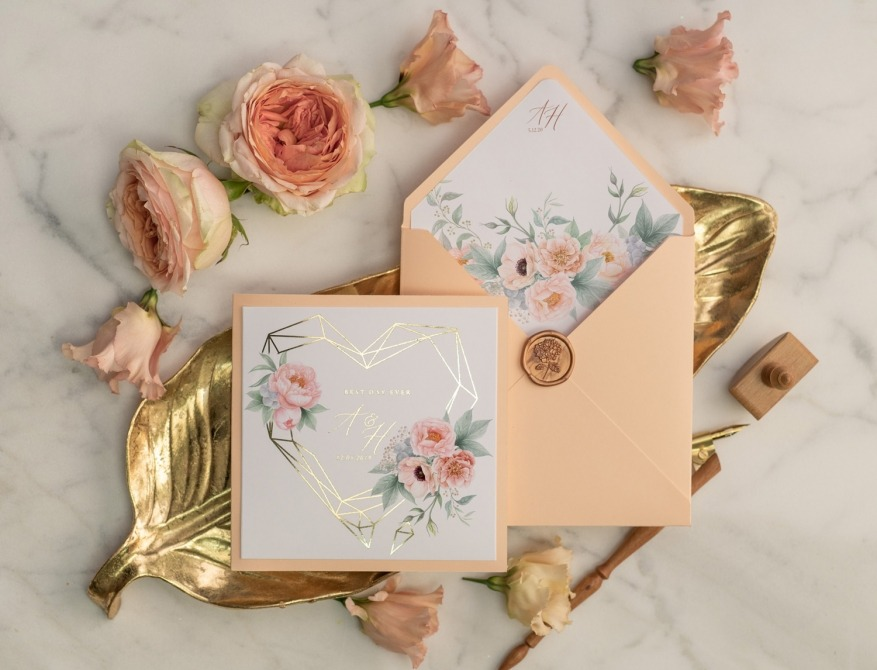 Peach and gold wedding invitations with flowers