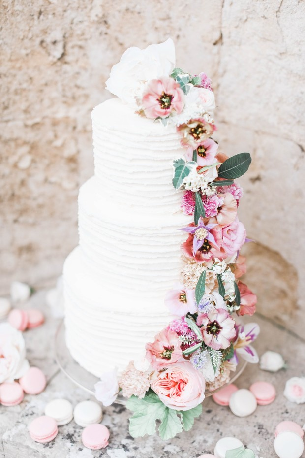 white wedding cake with cascading florals