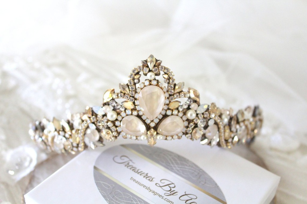 If you are searching for a wedding day accessory that will make you feel like royalty, this Swarovski crystal bridal tiara crown is