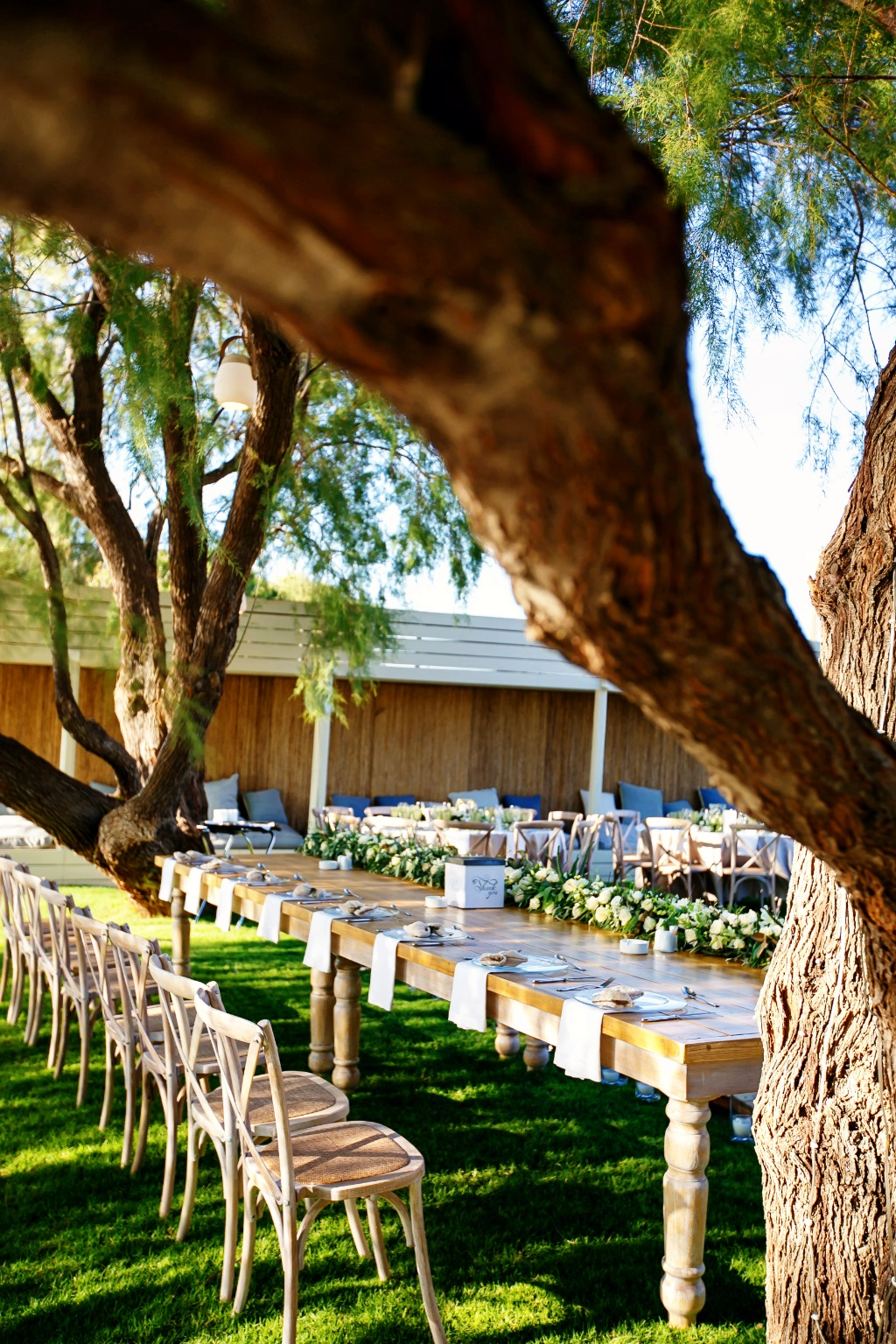 Organic wedding in Greece with lovely floral garlands and an outstanding setting in a garden venue.