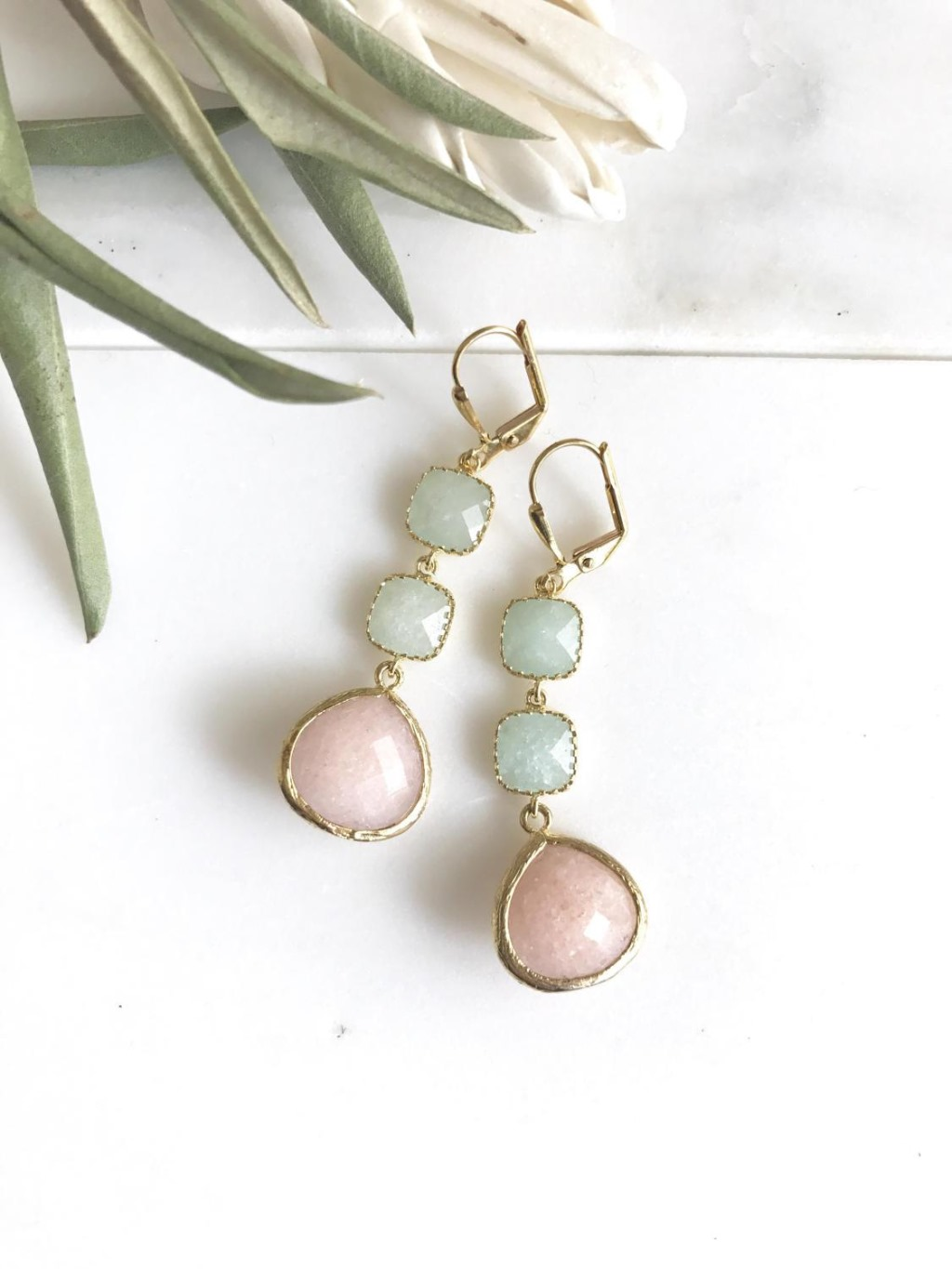 The teardrops are a peachy pink and are synthetic reconstructed stone which measure 15mm x 18mm. The earrings dangle about 1.75 inches