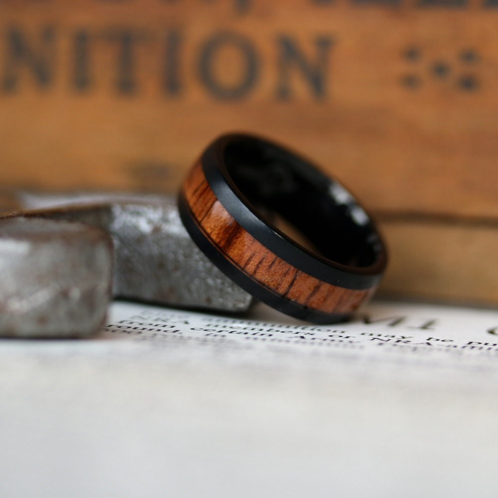 Men's wood wedding ring constructed out of a tungsten carbide core. Virtually indistinguishable on the finger making it ideal for men