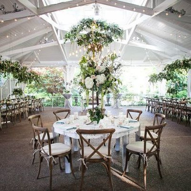 Lush greenery, vintage accents and a muted color palette came together for