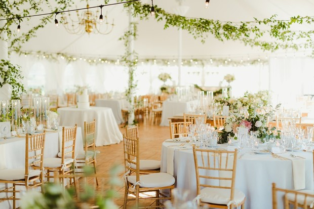 chic white and gold tented wedding venue