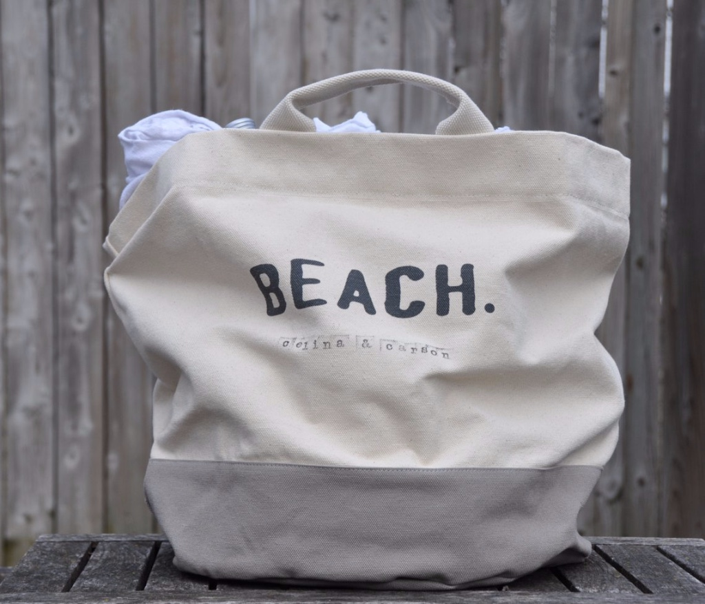 A customized honeymoon beach bag that will fit towels, champagne, love and more.
