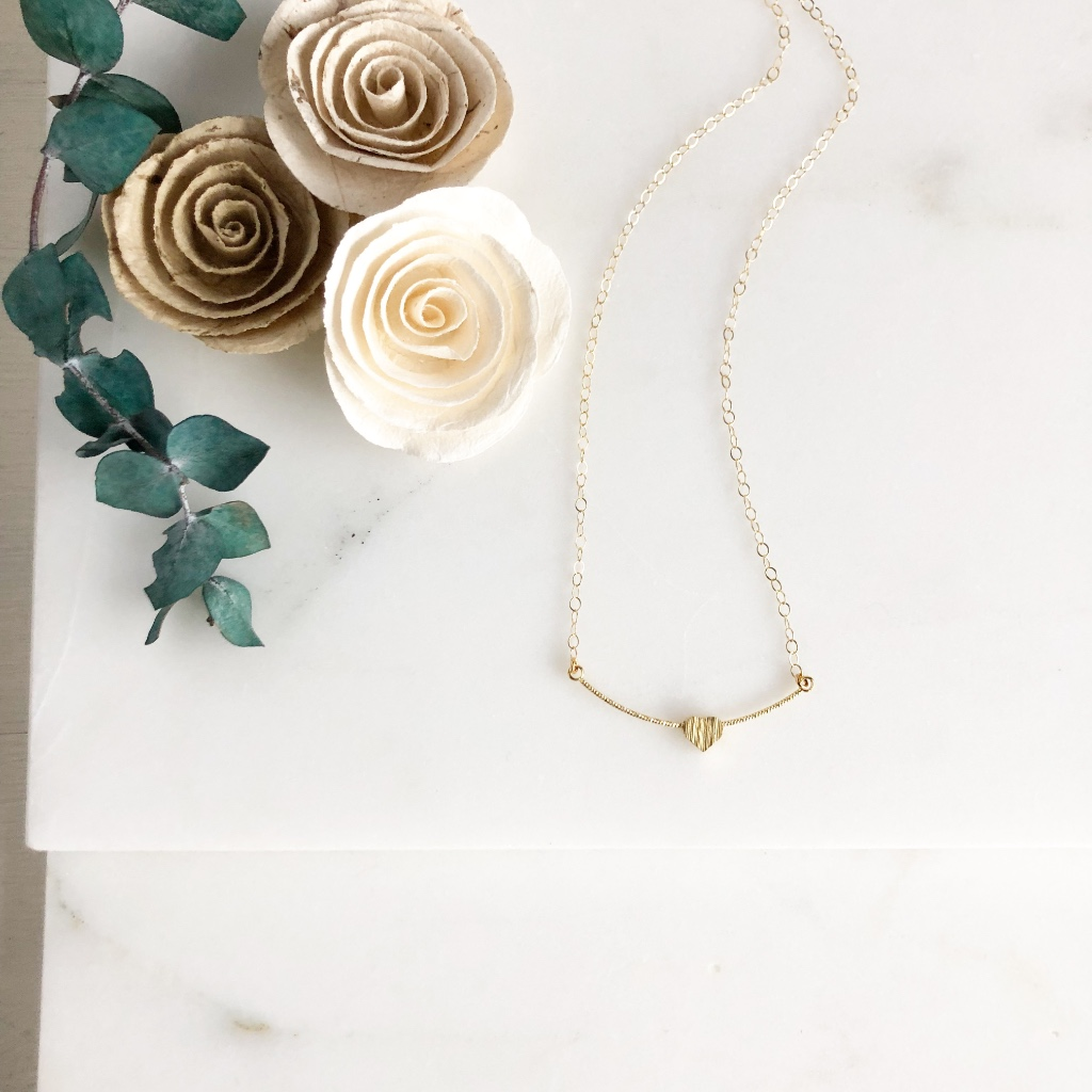 Super sweet necklace! The heart slides on the curved bar. The necklace is 18 long on 14k gold filled chain.
