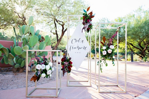 floating floral and and modern wedding sign