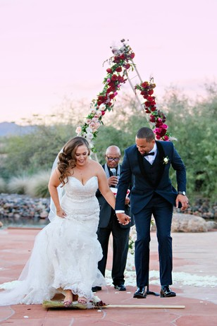 jumping over the broom stick