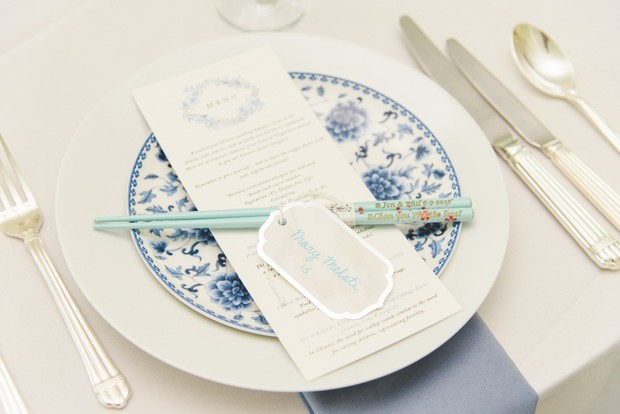 white and blue wedding place setting