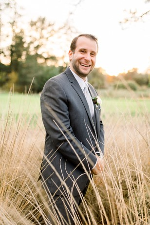 groom in tall grass