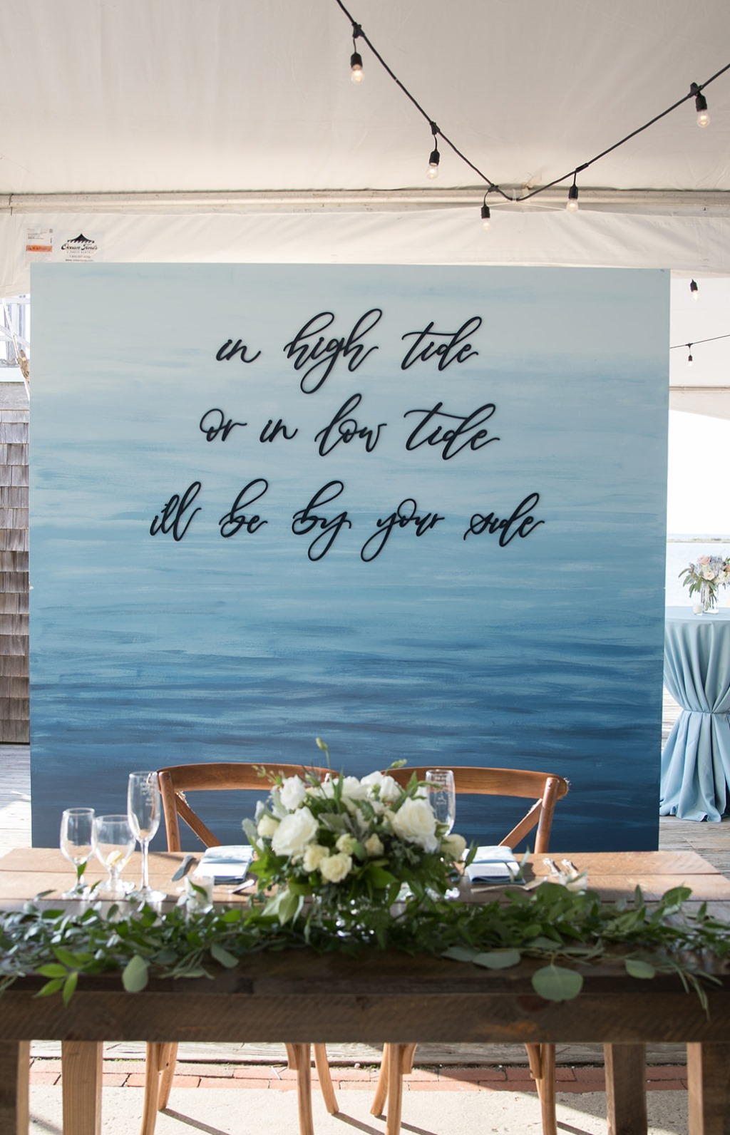 Custom ocean-inspired and painted sweetheart table backdrop.