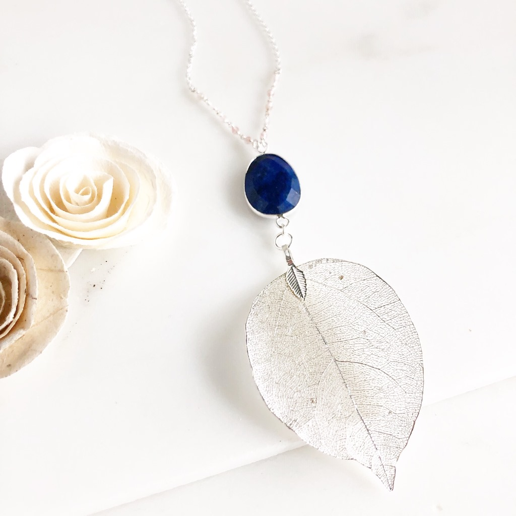 Long Silver Leaf and Lapis Lazuli Necklace. On 30 long sterling silver chain. Measures 4 from top of lapis stone to bottom of leaf