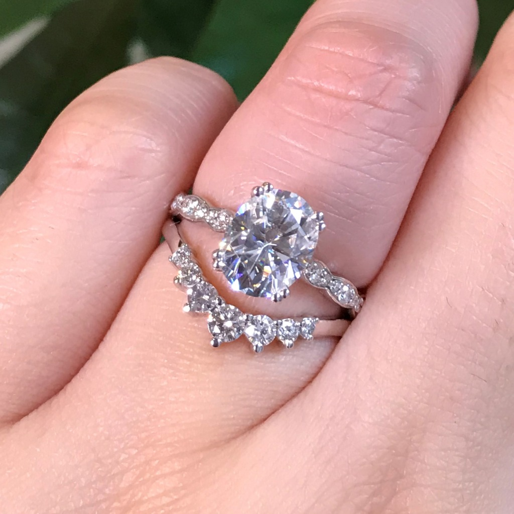 We love a Solitaire + Curved Wedding Band combo! White Gold Oval Solitaire Engagement Ring in Scalloped Diamond Band paired with a