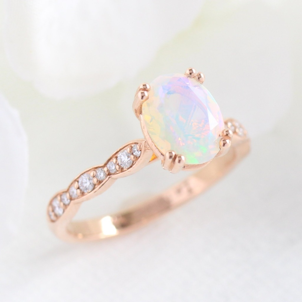 Beautiful play of color from this gorgeous Oval Solitaire Opal Engagement Ring in Scalloped Diamond Band in Rose Gold. See more from