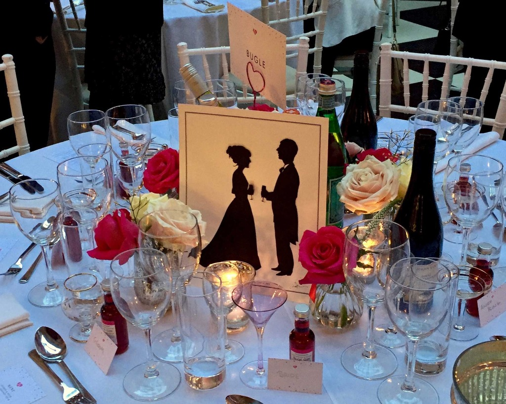 Table settings including personalised silhouettes of the couple.