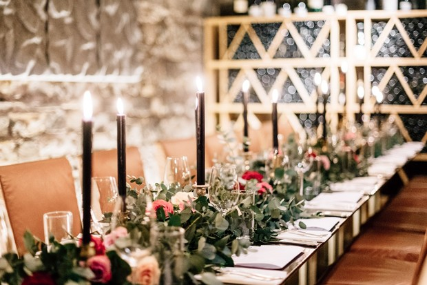 Romantic and elegant reception with black candles