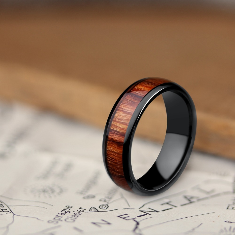 Mens Classic Black Wooden Wedding Ring. Crafted out of black high tech ceramic and inlaid with koa wood. The perfect wedding ring for