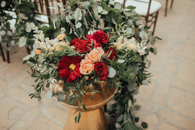 gold and burgundy and blush floral decor