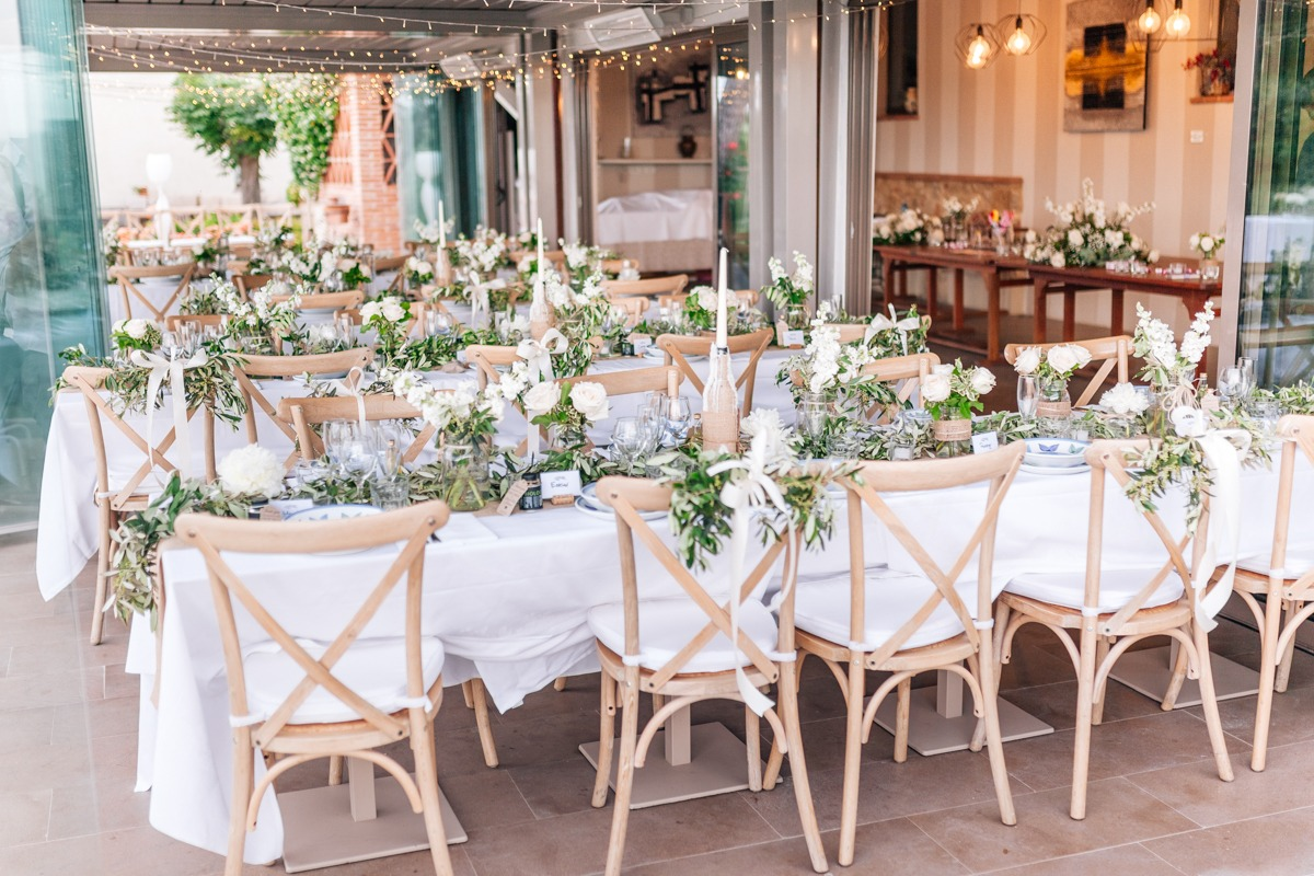wedding reception in lush greenery and neutral tones