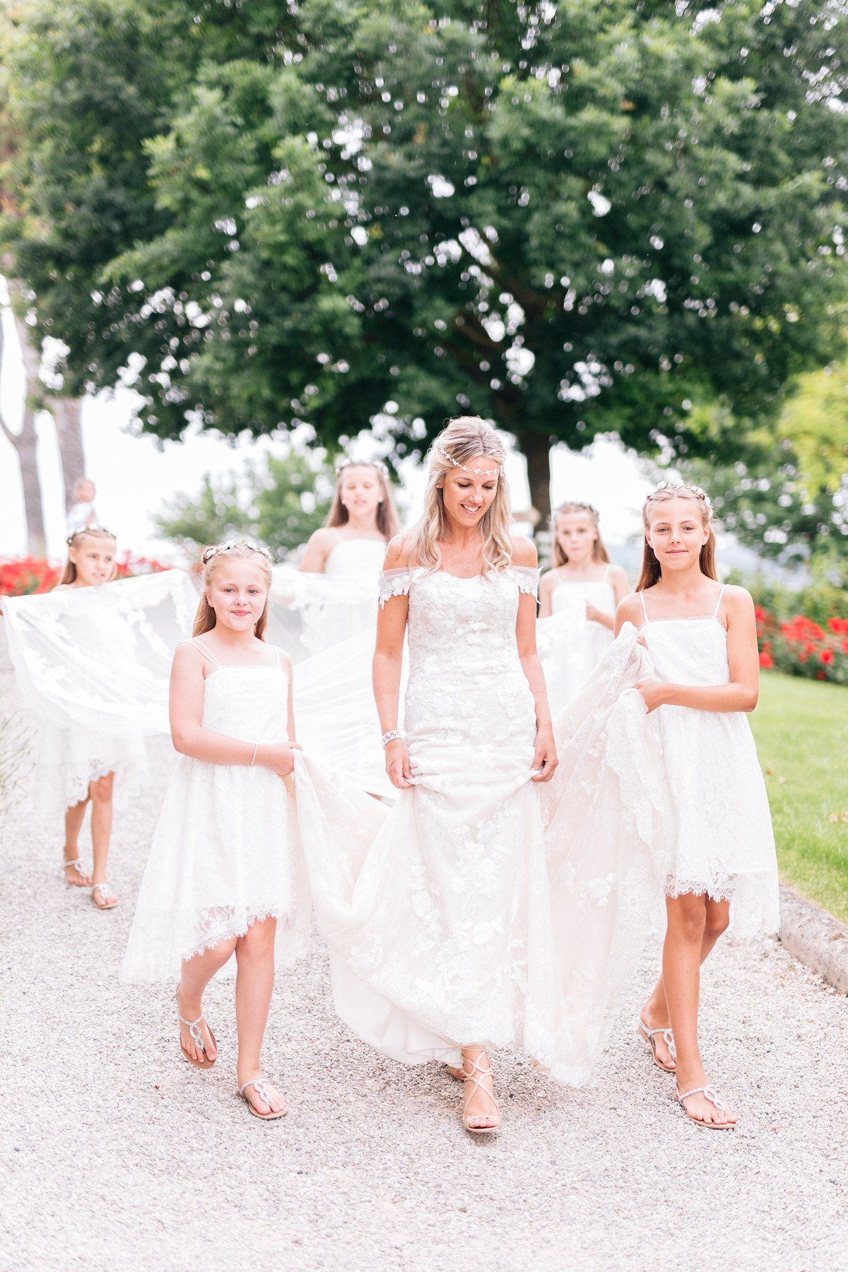 here comes the bride and all of her flower girls