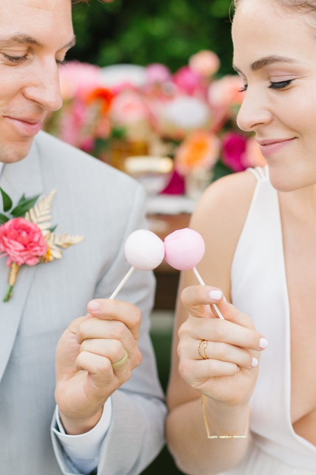 cake pop cheers for bride and groom
