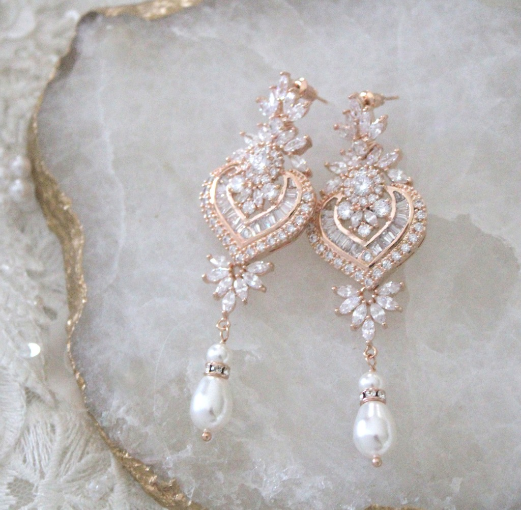 Versatile and delicate, this pair of long rose gold crystal and pearl chandelier wedding earrings can suit so many brides! Regardless