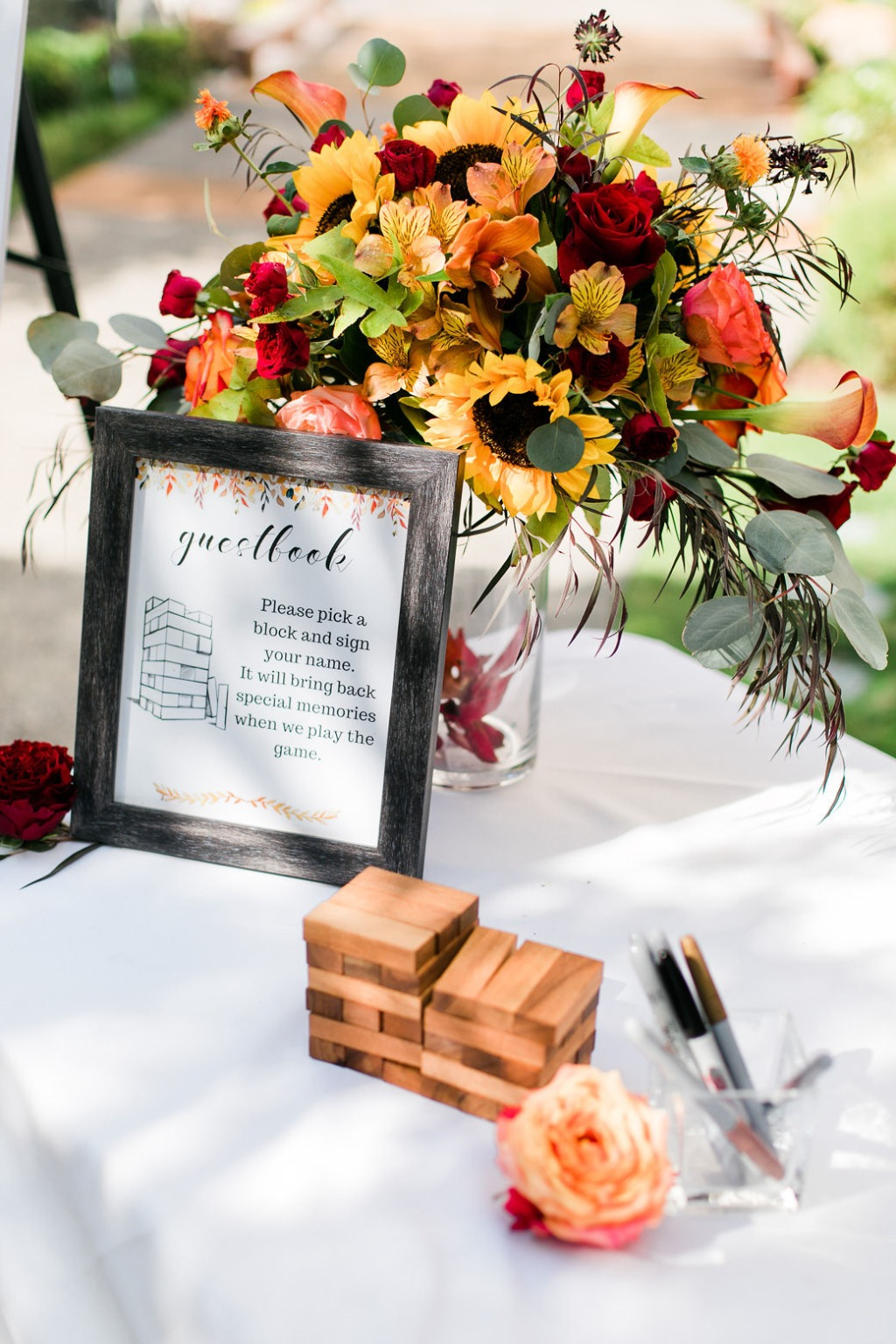 Looking for some unique ways to do a guestbook? Our creative couple decided to let their guests sign jenga blocks! Now they can read