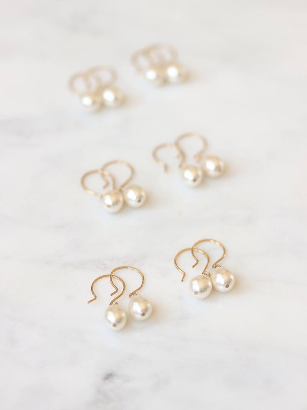 A set of six pairs of Moondrop Earrings, one for each of your bridal party.