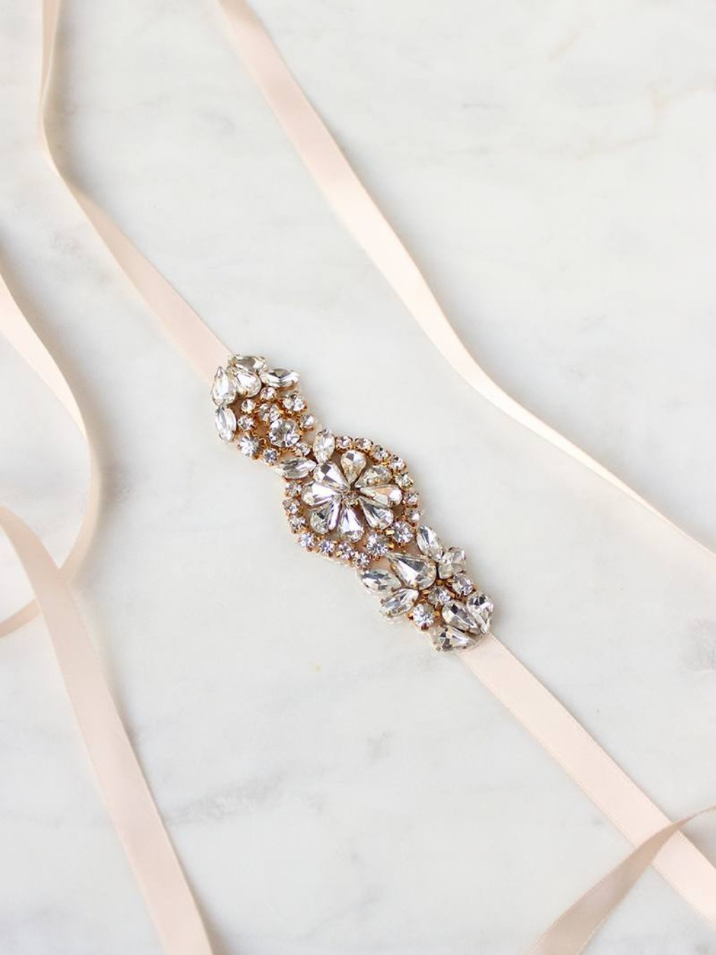 Finished with a satin sash and featuring gorgeous dewy rhinestones, the Bronte Petite Sash is one of our faves.