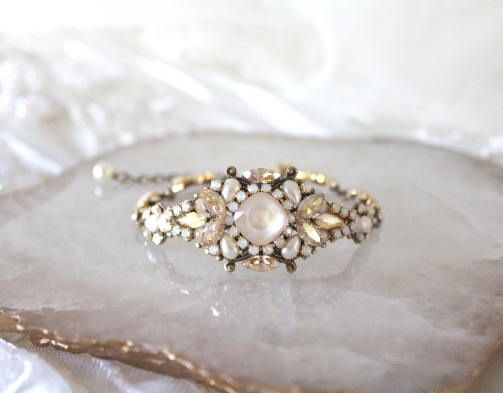 Beautifully handcrafted Antique gold Bridal bracelet with layers of Swarovski crystals make this piece an absolute heirloom you can