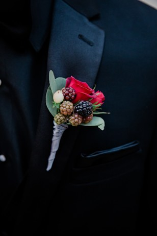 berry and rose boutonniere