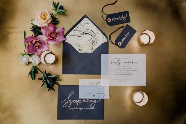 dramatic wedding invitation suite in black and gold