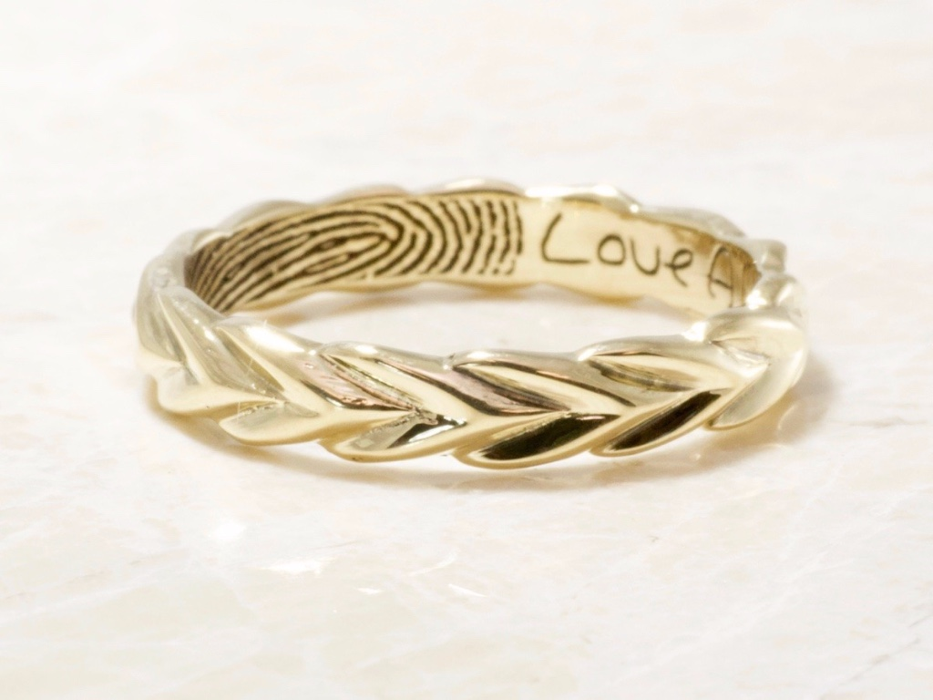 This 14k yellow gold, the 4mm band has hand-carved olive branch design, with your partner's fingerprint engraved on the inside of the