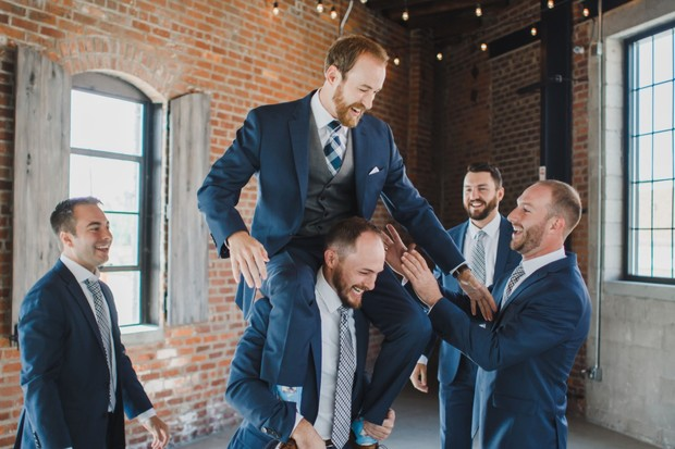 groomsmen in navy blue suits