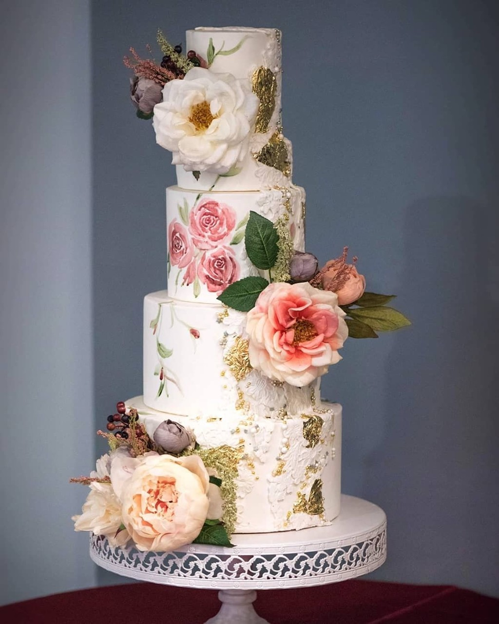 L🌸VE a pretty hand-painted floral wedding cake by @thesugarstream