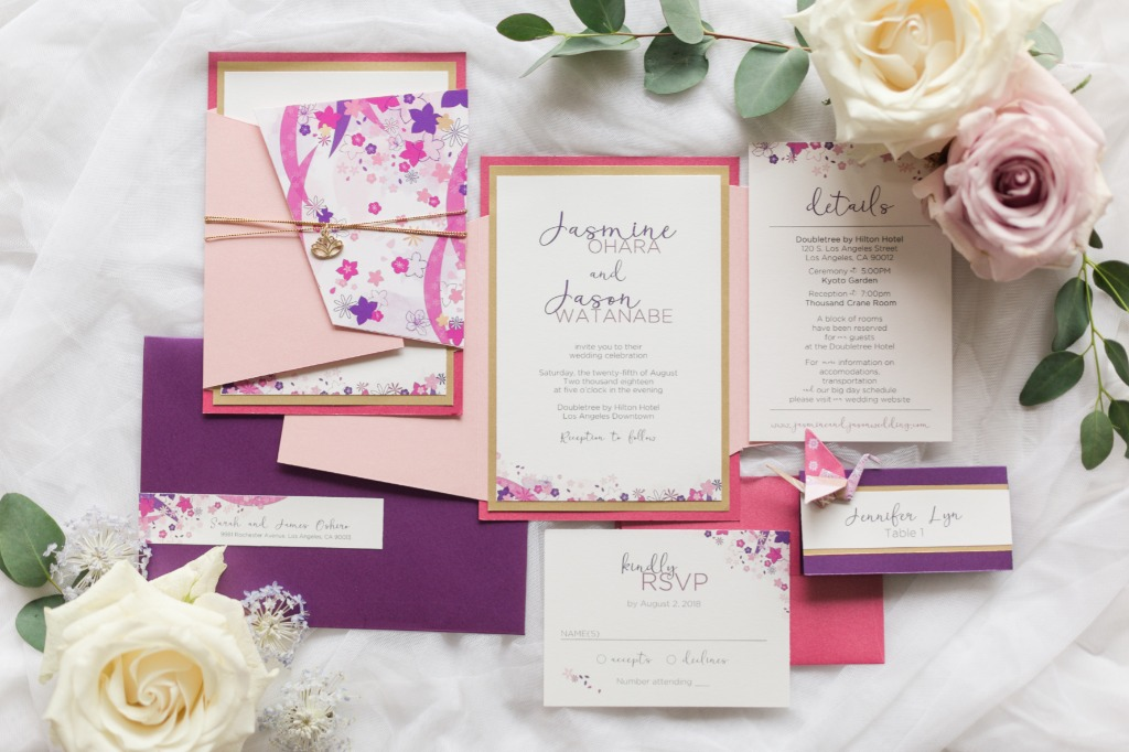 We're still swooning over the details of this beautiful invitation suite! It features beautiful custom washi paper cut as an asymmetrical
