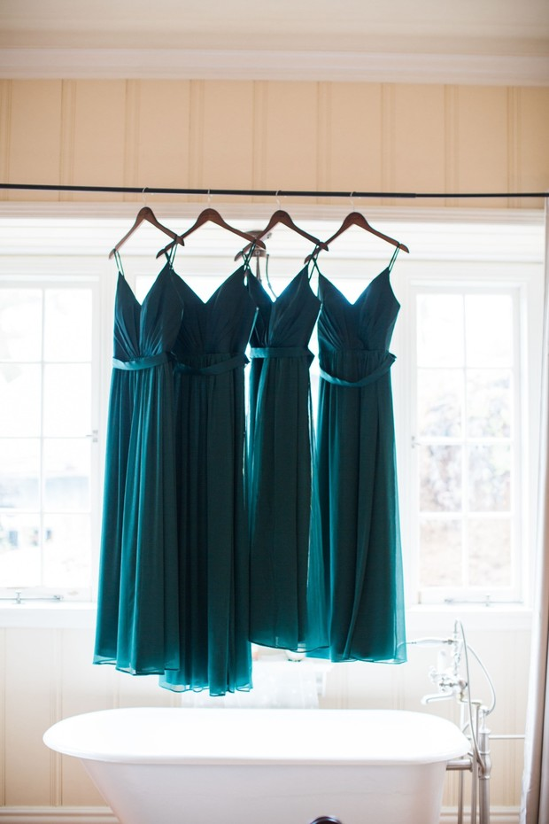 bridesmaids dressin in emerald green