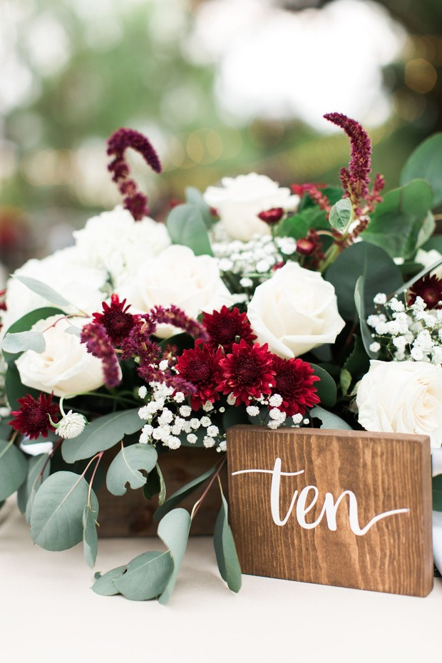 elegant white and burgundy centerpiece