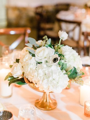 white and copper wedding centerpiece