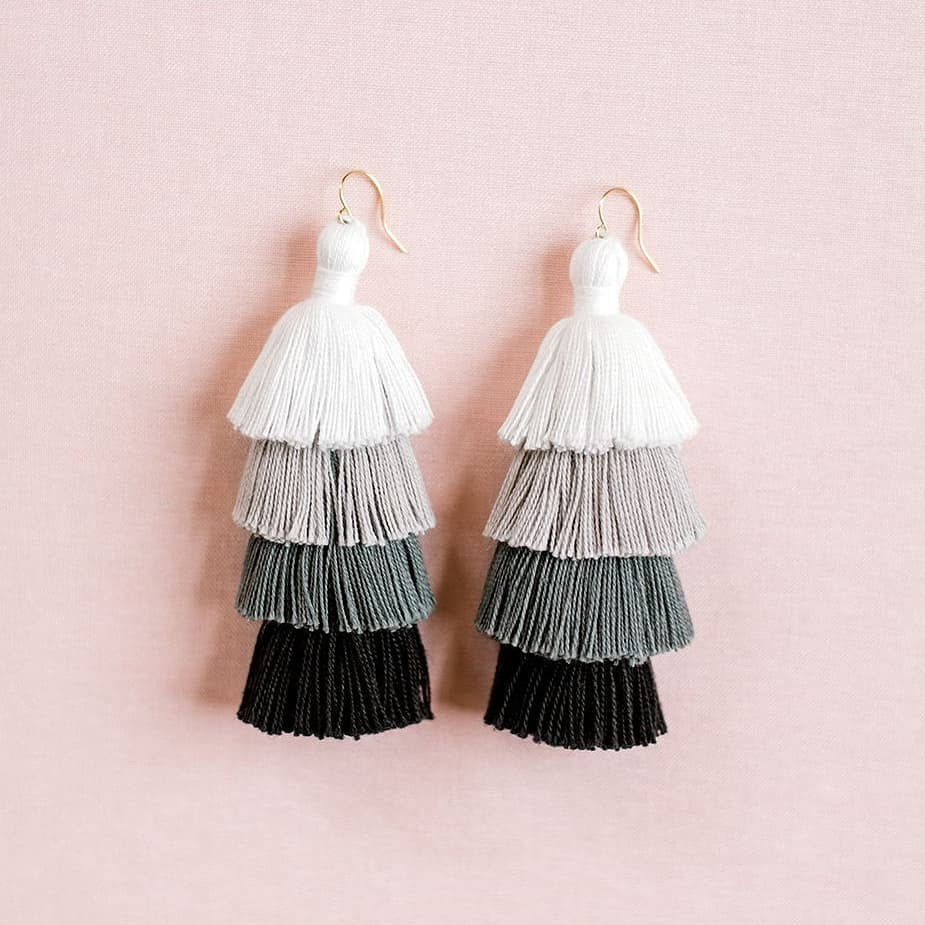 What's black and white and fluffy all over? These tassels! 😍 .
