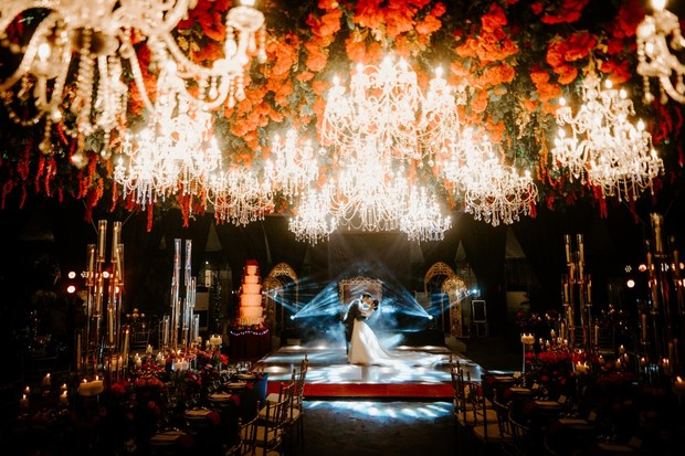 dramatic chandelier and flower ceiling wedding reception