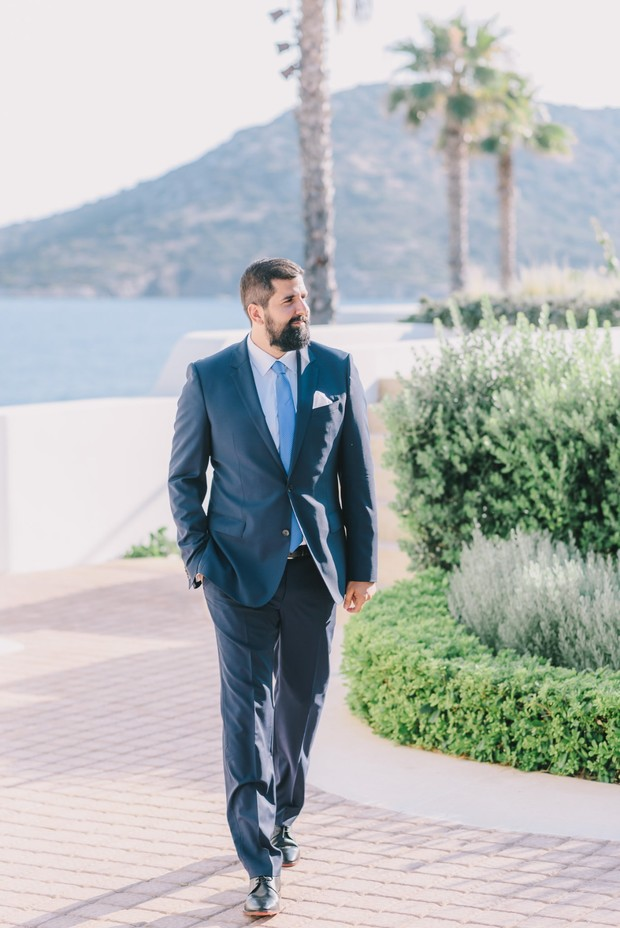 groom in blue suit and blue tie