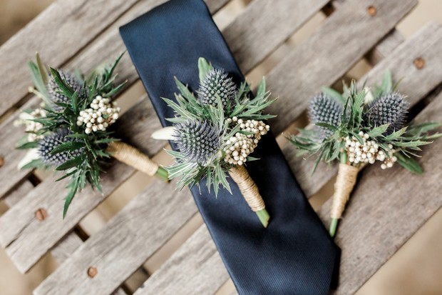 boutonnieres with blue thistle