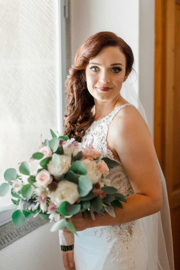 bride with side swept wedding hairstyle