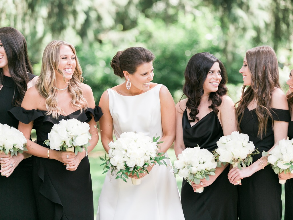 Sarah and Charlie's wedding reigned in the regal elegance department with a black and white color palette and a high neckline set off