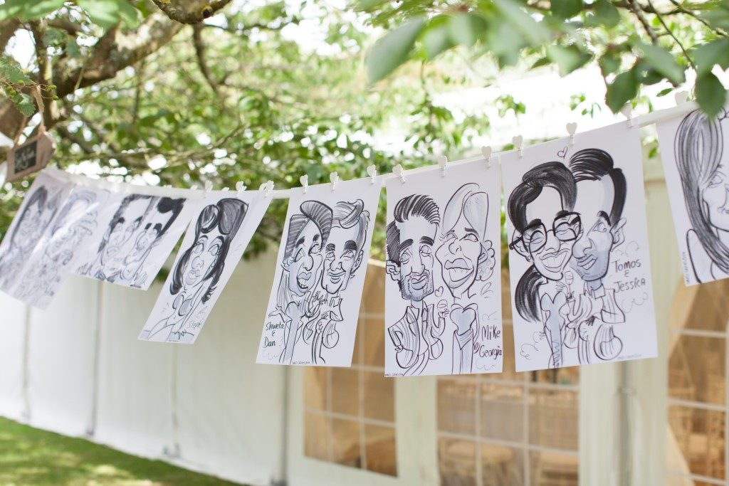 A lovely idea sent in by an artist who creates a party bunting effect with a collection of caricatures drawn during the day. Having