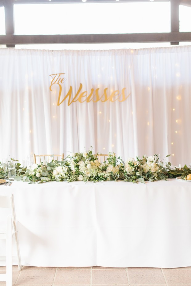 sweetheart table in white and gold